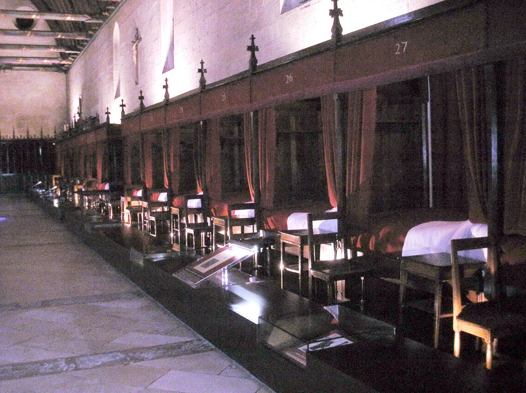 Row of beds in a hospice museum in Baume, France